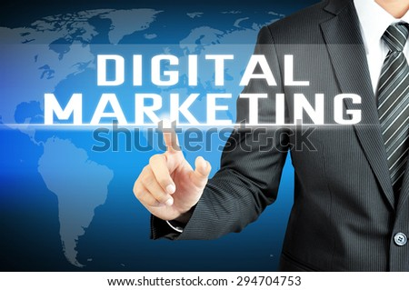 Businessman hand touching DIGITAL MARKETING sign on virtual screen
