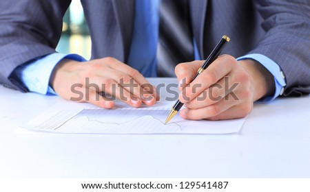 businessman hand with pen sign up contract document