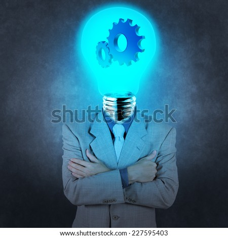 businessman has  light bulb head with gears as concept