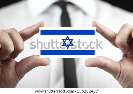 Businessman holding a business card with a Israel Flag