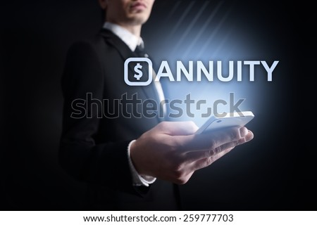 businessman holding a mobile phone with annuity text. Internet concept. business concept.