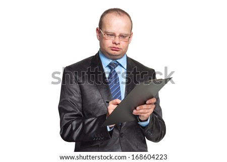 Businessman holding a tablet and writes something