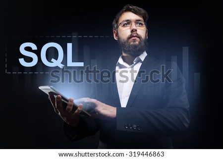 "Businessman holding a tablet pc with ""SQL"" text on virtual screen."