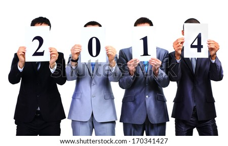 Businessman holding boards The New Year 2014 on white background