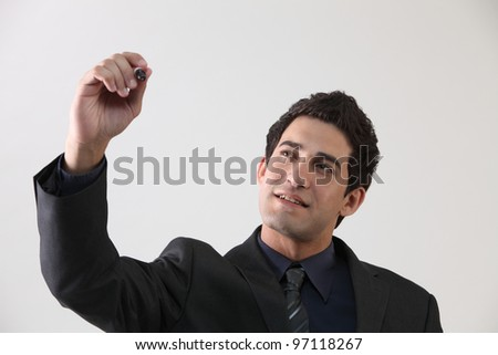 businessman holding marker pen doing presentation