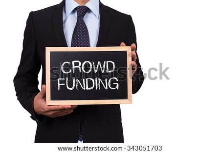 Businessman holding mini blackboard with CROWD FUNDING message
