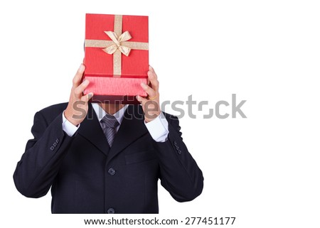 Businessman holding red gift box isolated background.