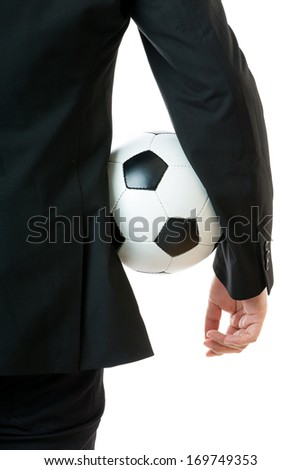Businessman holding soccer ball