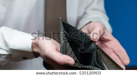 businessman holds a purse in his hand
