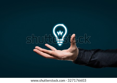Businessman holds a virtual icon in his hand