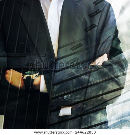 Businessman in front of city background