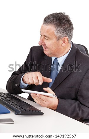 Businessman in office with tablet PC