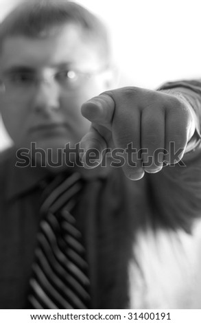 businessman, indicating a finger