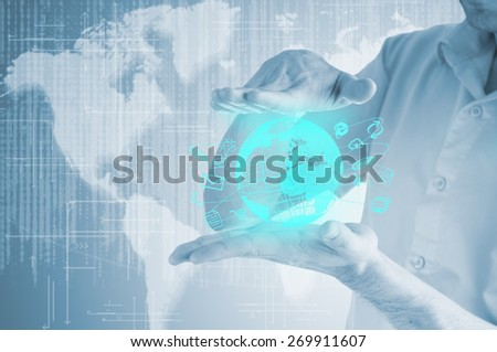 Businessman is holding a virtual communication with virtual earth.