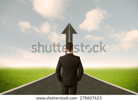 Businessman lokking at 3d road upgoing arrow concept