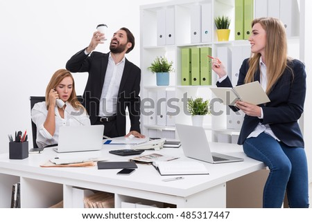 group colleagues office man reading manual stock photo 477925987 shutterstock. Black Bedroom Furniture Sets. Home Design Ideas