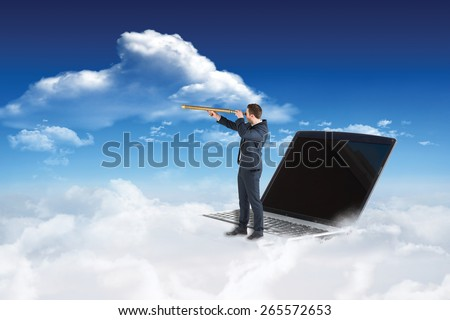 Businessman looking through telescope against bright blue sky with clouds