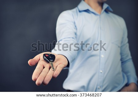 Businessman offering a car key