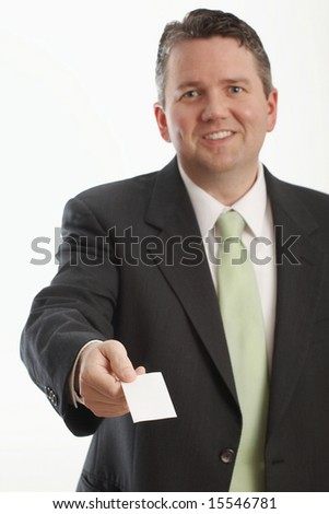 Businessman offering business card focus on hand