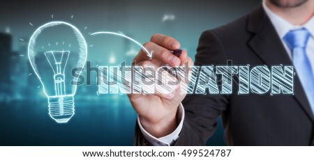 Businessman on blurred background drawing a sketch lightbulb innovation concept