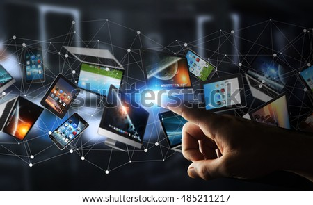 Businessman on dark background connecting tech devices 3D rendering