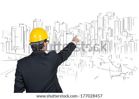 Businessman pointing out construction process 2