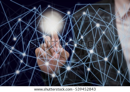 Businessman pointing with digital network line and circles on dark background, business technology concept