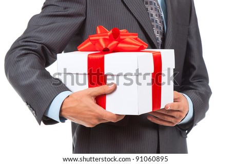 Businessman present white gift box with red ribbon bow, isolated over white background.