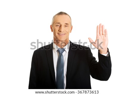 Businessman pressing abstract screen