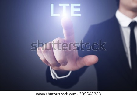 "Businessman pressing button on virtual touch screen  and select ""LTE"". Business concept. Internet concept."