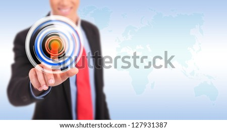 Businessman pressing circle button on a virtual background