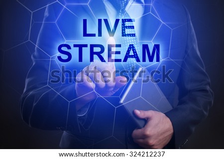 "Businessman pressing touch screen interface and select ""Live stream""."