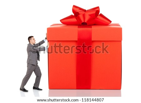 Businessman push big gift box full length concept. Business man present red gift box with ribbon bow Isolated over white background