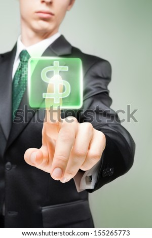 Businessman pushing virtual button with dollar sign.