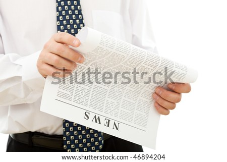 Businessman reading news from paper - isolated closeup