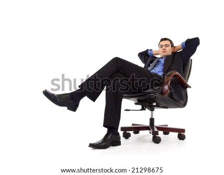 Businessman relaxing in armchair - isolated