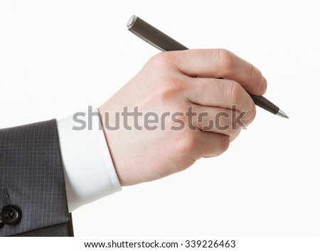 Businessman's hand holding a pen, white background