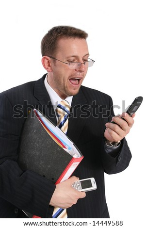 businessman screaming at cell phone