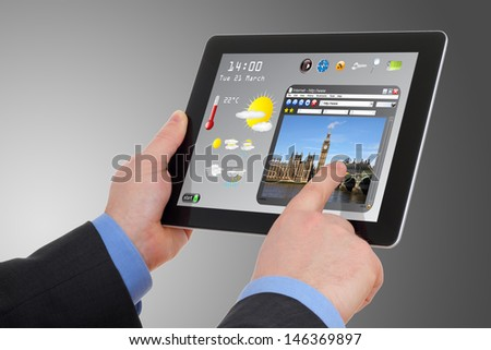 businessman searching a tourism information on tablet