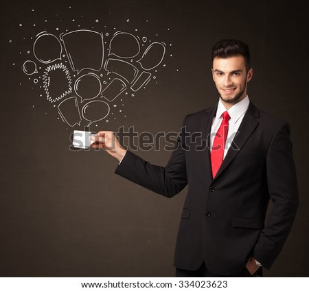 Businessman standing and holding a white cup with drawn speech bubbles coming out of the cup