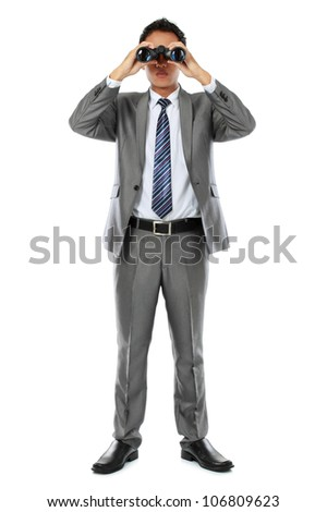 businessman standing and holding binocular isolated over white background