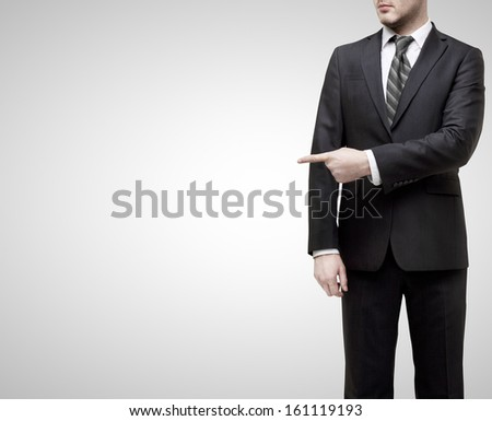 businessman standing and showing  finger to something