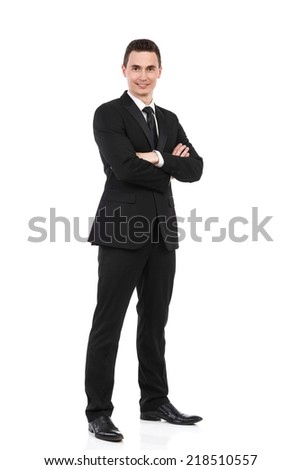 Businessman standing with arms crossed. Happy young office worker waiting with arms crossed. Full length studio shot isolated on white.