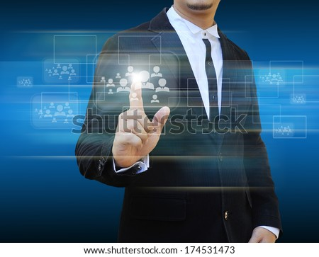 Businessman touching social network icons.
