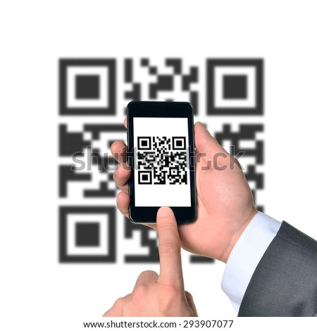 Businessman using smartphone with QR-code on isolated white background with code