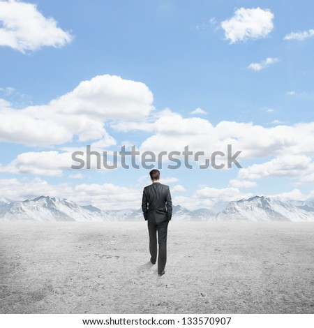 businessman walking and blue sky