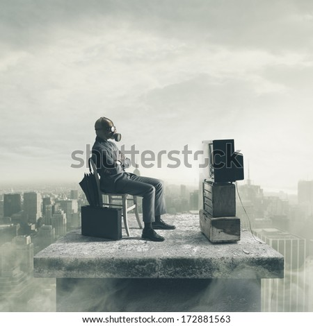 Businessman wearing a gas mask watching TV