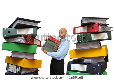 Businessman with a big pile of files isolated in white