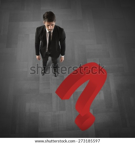 Businessman with a big red question mark