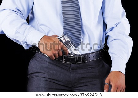 Businessman with a handgun
